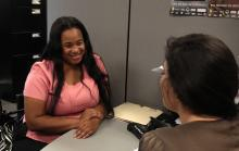 Woman receiving assistance counseling from ACCESS professional.