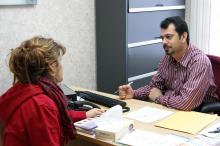 ACCESS professional giving translation services to a woman.