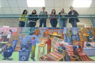 Teen Grantmaking Initiative members with a mural